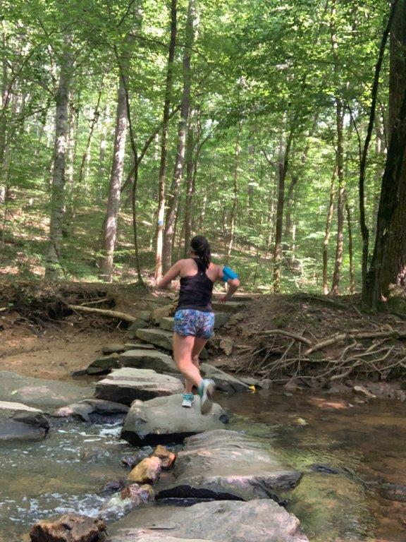 Running through a creek crossing on the Loblolly trail in Umstead State Park.