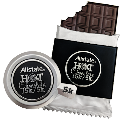 The 5k has a silver 'mug'-shaped medal, and the 15k is in the shape of an unwrapped bar of chocolate.