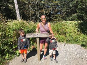 Standing in front of the Appalachian Trail sign by Clingmans Dome with my two boys.