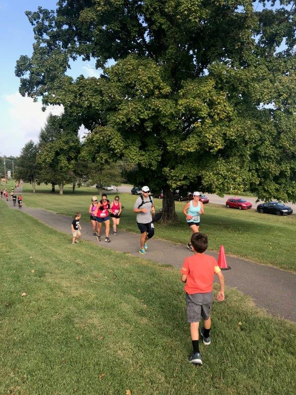 Running towards the last 0.2 miles of the course and spotted by my kids. They ran up to greet me and run me to the finish line.