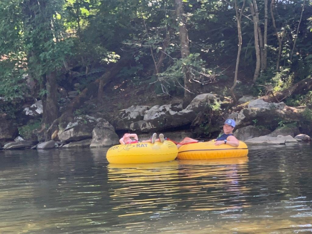 Floating with my youngest in a yellow inner tube down the river.