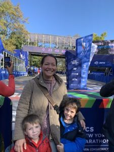 Standing in front of the finish line with my boys the day before the race.