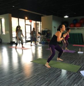 All smiles teaching a PiYo class at Ladies Fitness and Wellness.
