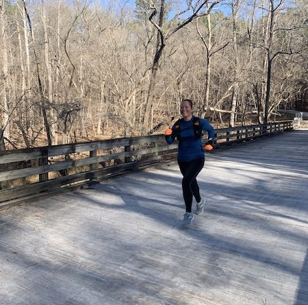 Crossing a frosty bridge in Umstead Park in Raleigh, NC.